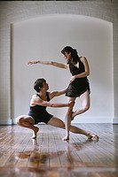 Ballet dancers practicing together in a room