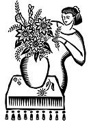 A woman making a floral arrangement