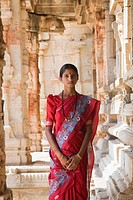 Woman standing in a temple, Krishna Temple, Hampi, Karnataka, India