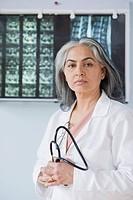 Portrait of a female doctor holding a stethoscope, Gurgaon, Haryana, India