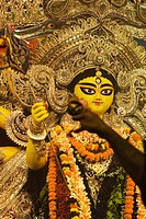 Pandit praying in front of goddess Durga, Kolkata, West Bengal, India