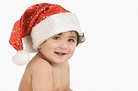 Close_up of a baby boy wearing a Santa hat