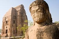Statue with temple in the background, Teli Ka Mandir, Gwalior, Madhya Pradesh, India