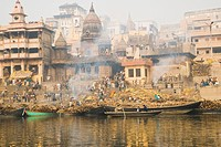 Firewood on the boats with cremation of dead bodies at a ghat, Manikarnika Ghat, Ganges River, Varanasi, Uttar Pradesh, India