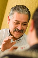 Hispanic men playing cards