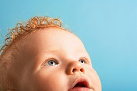 Redheaded baby looking up