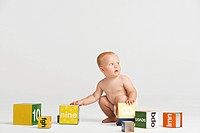 Baby Picking Up Blocks (thumbnail)