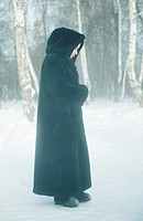 Nun standing in the snow, Omsk, Siberia