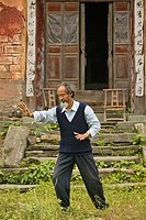 Taichi master demonstrating Taichi in front of his old house at the foot of Mount Wudang, Wudang Shan, Taoist mountain, Hubei province, Wudangshan, Mo...
