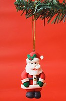 Santa Claus figurine hanging on a Christmas tree