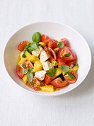 Tomato and mango salad with mozzarella and basil
