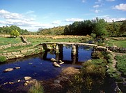 Dartmoor _ The ancient Clapper bridge over the East Dart River at Postbridge