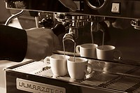 Two cups of espresso being filled