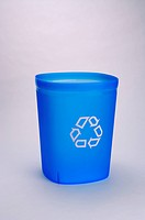 Blue recycling bin with a white recycling symbol on it