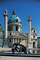 Rear view of tourists in front of a church, Karlskirche, Vienna, Austria