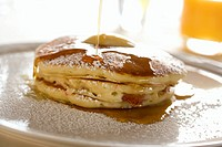 Syrup Pouring Over Pancakes