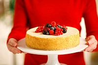 Woman Holding New York Cheesecake with Fruit