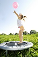 Meadow, girl, trampoline, jumps, ball, throws up, cheerfully, sidewards, back light, series, people, child, toddler, blond, top, Short, barefoot, play...