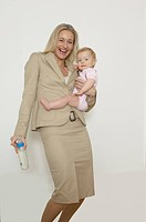 Mother, laughing, baby, vial, symbol, holds career, education series, people, two woman, 30_40 years, child, occupation, business, looks after, cheerf...