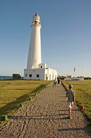 Lighthouse and tourists at evening  La Paloma, Rocha, Uruguay