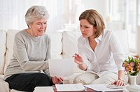 Mature woman giving financial advice to senior woman