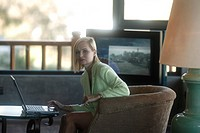 businesswoman, sitting, hotel armchair, laptop, does, interior