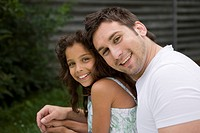 Father, daughter, embraces, smiling, lovingly, portrait, outside,