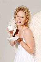Woman, young, blond, angel wings, smiling, drinks cheerfully, coffee_cup, enjoying, semi_portrait, christmas, people, christmas_angels, angels, angel_...
