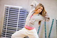 Young woman in gym, dance exercise, aerobics, fitness