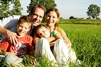 Sits family, meadow, laughs cheerfully, summer,