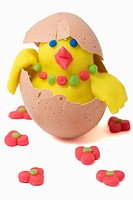 Plasticine figurines. Female chick in egg shell
