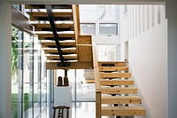 Interior of modern house, wooden stairway