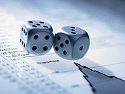Silver dice on list of share prices (thumbnail)