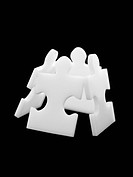 Four puzzle pieces leaning in box formation (thumbnail)