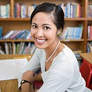 Teacher sitting in library