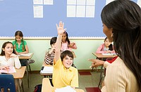 Teacher calling on student in classroom