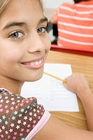 Girl doing school work in classroom