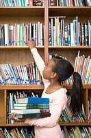Girl taking books from school library