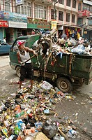 Man loading trash into a truck Thamel, Kathmandu, Nepal