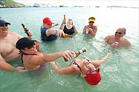 Sint Maarten, Philipsburg, cruise ship passengers having a morning beer in the shallow water of Philipsburg beach