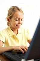 Girl using a laptop computer