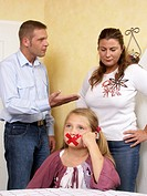 Couple with daughter, glue strip on mouth, lips are sealed