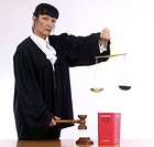 Judge with scale, judge´s gavel and code, court, jurisdiction, justice, lawyer, disbalance, balance