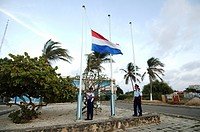 Netherlands Antilles, Bonaire, raising the Dutch flag at the police station
