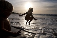 Saba, children playing on remote beach of Wells Bay