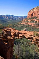 Couple sitting on arch  Sedona, Arizona