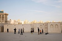 Children playing football in a backyard in Sharjah, UAE