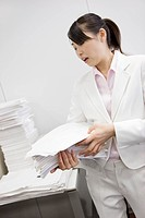 Office lady putting documents in order