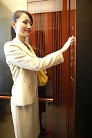 Japanese office worker in an elevator