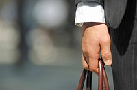 Hand of the businessman with the bag